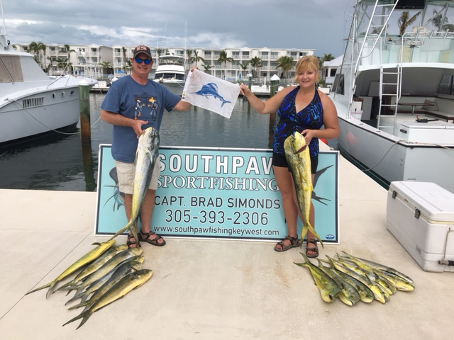 Couple posing with fresh caught mahi mahi