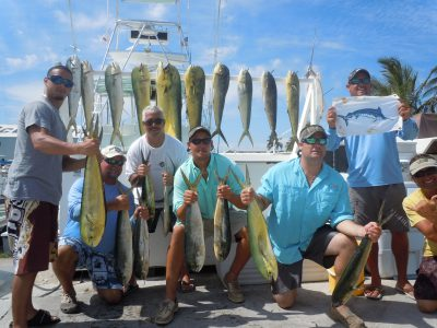 7 men holding fish from a key west fishing charter