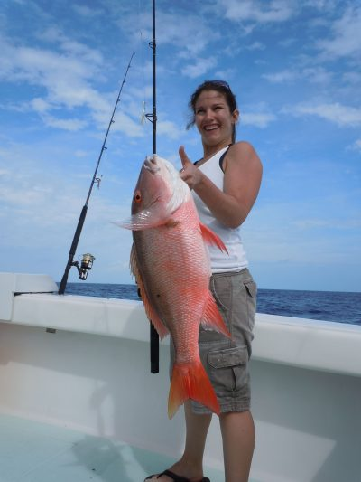 Woman holding a mutton snapper