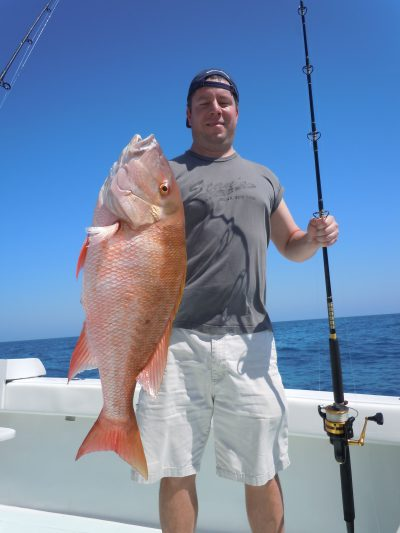 Customer and mutton snapper in key west