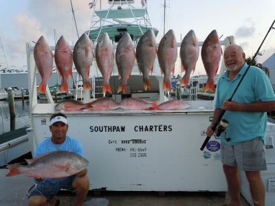 crew, client and 14 mutton snappers at the dock