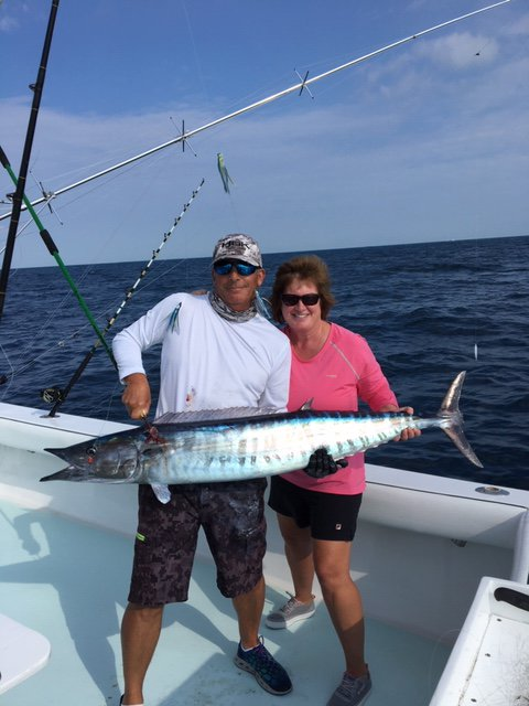 Crew and customer holding a wahoo