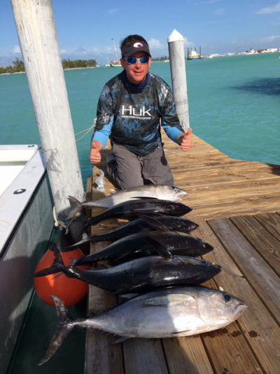 6 black fin tuna on the dock