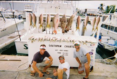3 men and their catch from the southpaw in key west, fl