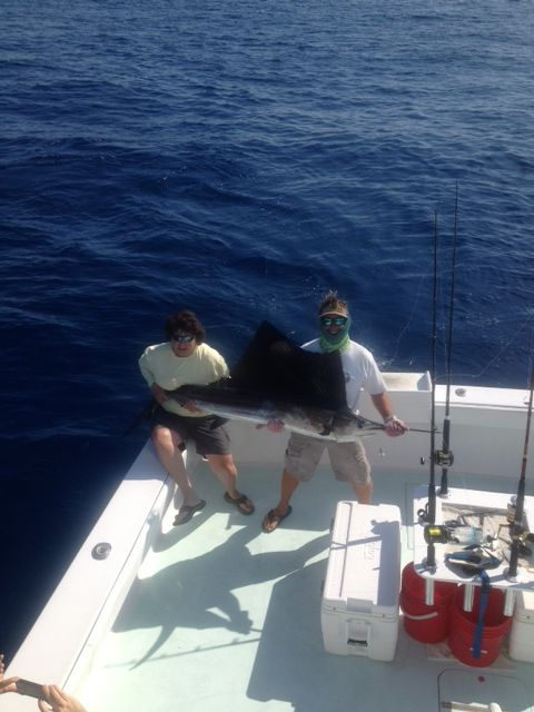 Client and mate holding a Sailfish on deck