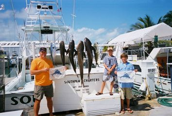 Charter group at the dock with their catch