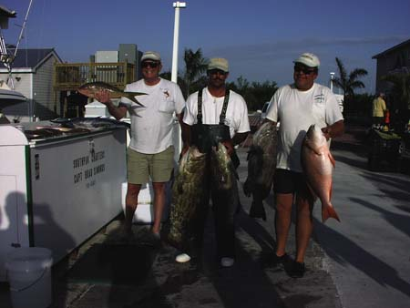 Charter holding their catch at the dock