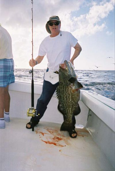 Man holding black grouper in Key West waters