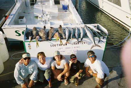 Family charter with their catch