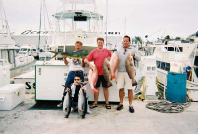 Happy fishing charter with 2 tuna, 2 grouper, a mutton snapper and dolphin