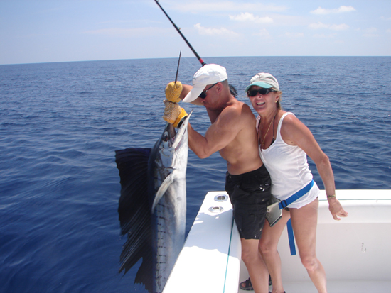 Couple holding a marlin