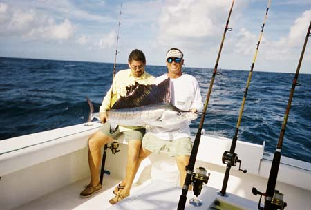 Client and fishing mate holding a sailfish